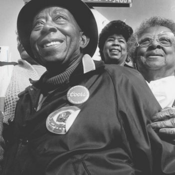 12-1985 - Daddy Bruce is full of smiles at the street dedication for him by his restaurant . Two of his sisters are with him as the Thanksgiving feast got under way. (Photo by Jim Preston/The Denver Post)